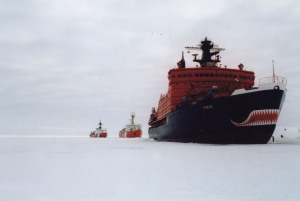 A Russian icebreaker clears a path for two Canadian Coast Guard ships.