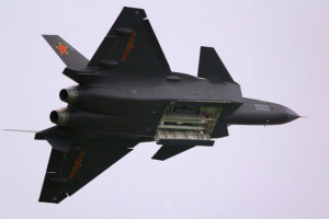 J-20 doing a fly-past showing off its internal weapons bay.