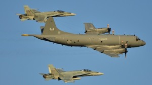Aurora CP-140 escorted by fighter jets