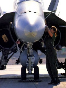 An aircraft technician performs a pre-flight check on a CF-188 Hornet in Qatar.