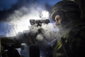 A member of Bravo Company 3rd Battalion Royal 22e Régiment fires a C9 light machine gun during the final assault during Exercise RAFALE BLANCHE in Valcartier