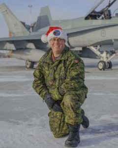Master Corporal Joshua Correia, from 409 Tactical Fighter Squadron at 4 Wing Cold Lake, Alberta, is one of the maintenance crew chiefs for the 2016 NORAD Tracks Santa Mission. PHOTO: Corporal Sophie Renaud