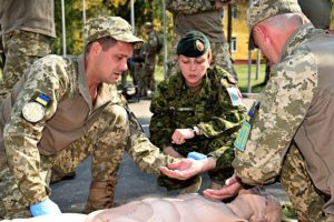 Starychi, Ukraine. September 2, 2016 – Sergeant Marnie Musson, a Medical Technician with Joint Task Force - Ukraine, mentors Combat First Aid training at the International Peacekeeping and Security Centre during Operation Unifier. (Photo: Joint Task Force Ukraine)